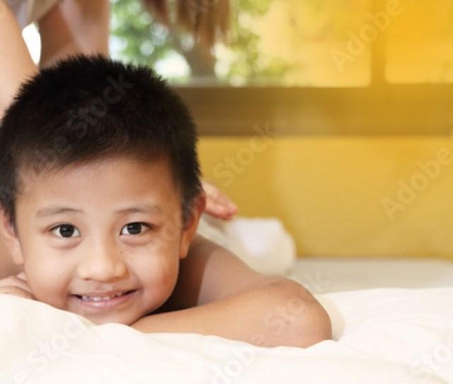 Asian Kid Getting A Massage