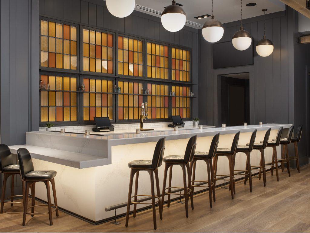 Hardwood window system & quartz bar facade & countertops
