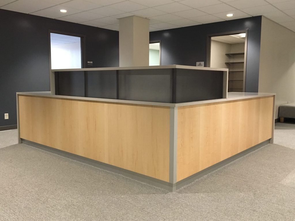 Veneer cabinetry & solid surface countertops