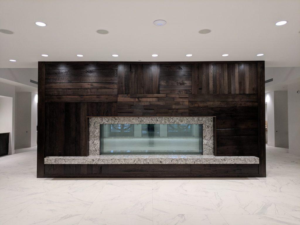 Reclaimed hardwood fireplace & quartz mantel