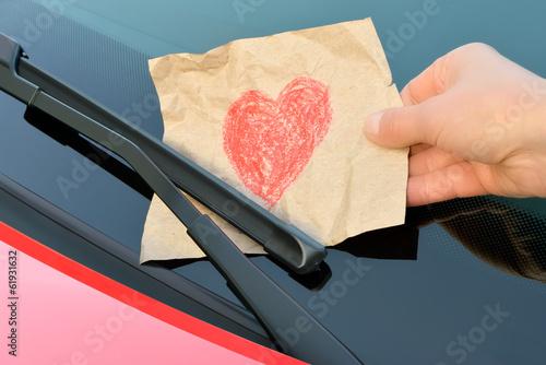 love letter under a windshield wiper