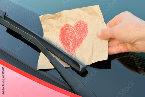 love letter under a windshield wiper