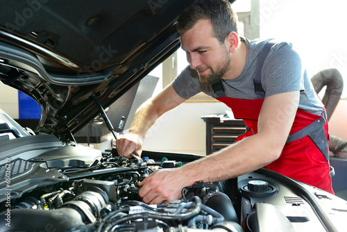 professional mechanic repairs engine of car