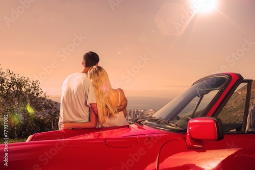 Rear view of couple hugging and admiring panorama