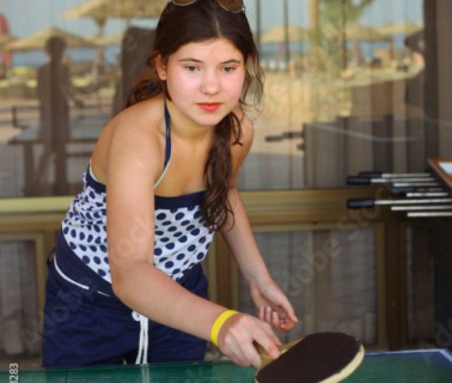 Preteen Beautiful Girl Play Table Tennis In The Beach Resort Hot