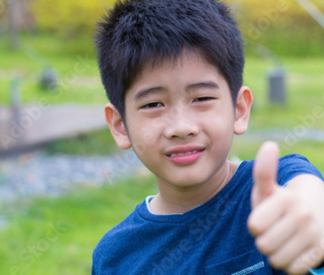 Asian Young Boy A Cute Asian Thai Young Boy With Thumb Up