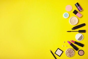 face Make Up  photos  royalty free images  graphics  vectors     Make up and cosmetic products arranged on a vibrant yellow background  with  blank space at