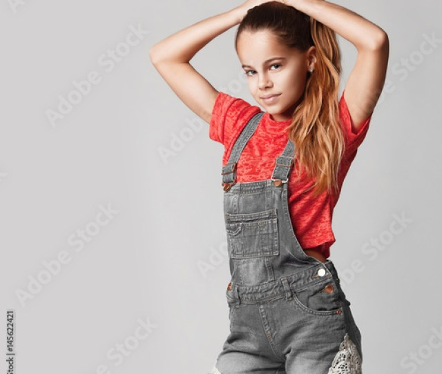 Cute Teen Girl Smiling Studio Portrait Of A Teenage Girl In Jeans And A T Shirt A Teenage Girl With Long Thick Hair