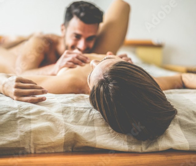 Young Couple Making Passionate Foreplay Before Sex In Hotel Room