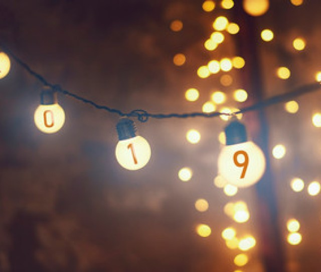 New Year Background Garlands And Lanterns That Hang On A Single Wire And Shine With