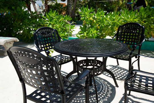 https stock adobe com images outdoor cafe with black metal table and chairs on tropical island 297645214 start checkout 1 content id 297645214