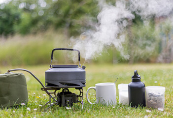 Kettle boiling a cup of tea whist camping