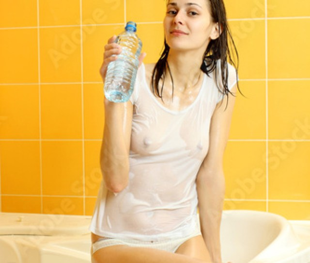 Nude Sexy Girl In Wet T Shirt Drinks Water