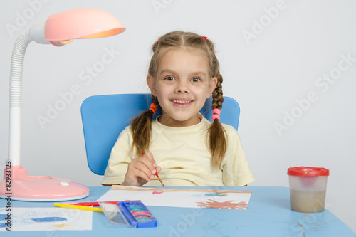 """Six Year Old Girl Smiling Happily, Drawing The Table"