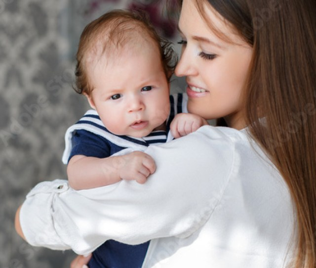 Portrait Of Mother And Childbeautiful Mombrunette With Long Straight Hairdressed