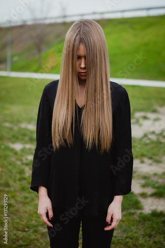 Blond Girl With Long Blonde Hair Covering Her Face Stock Photo And Royalty Free Images On
