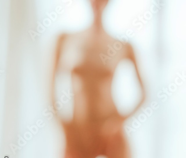 Blurred Image Of A Sexy Woman Without Clothes In Front Of A Wind