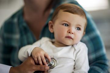 Baby boy having a medical check-up.