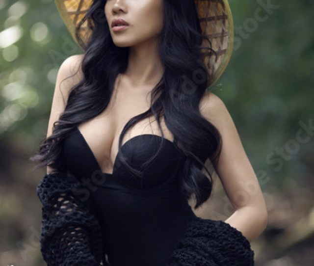 Young Sexy Vietnamese Girl In A Straw Hat In A Tropical Forest