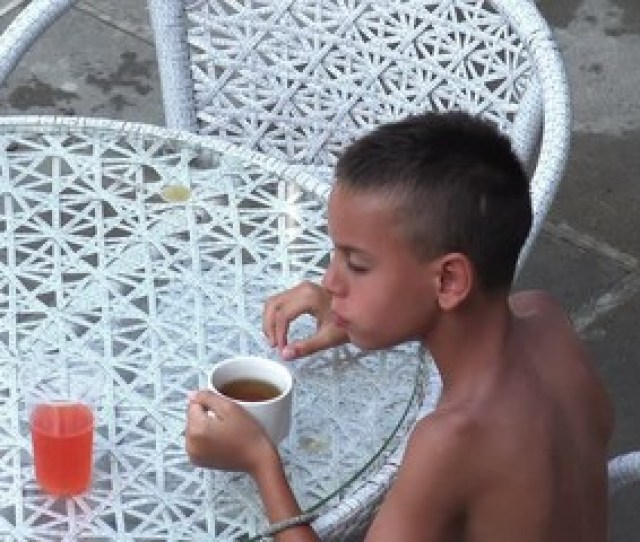 028 Cute Little Naket Boy Sitting At The Table Drinking Juice