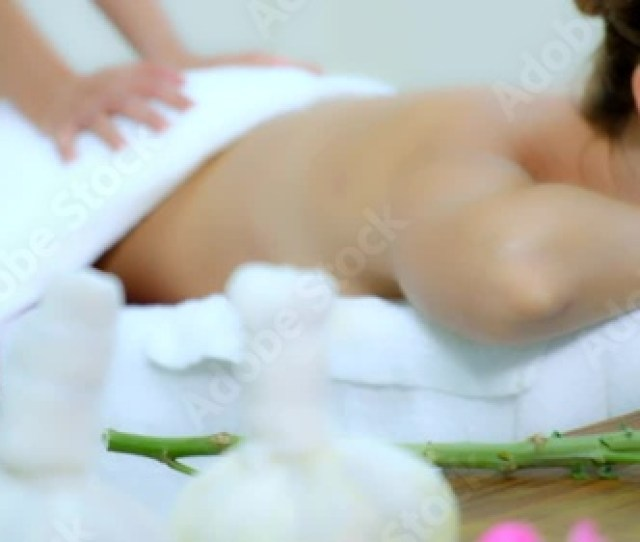 Peaceful Women Enjoying A Massage Ass And Back At The Spawoman Having Therapy Massage Of Back In The Spa Salon Slow Motion Stock Footage And
