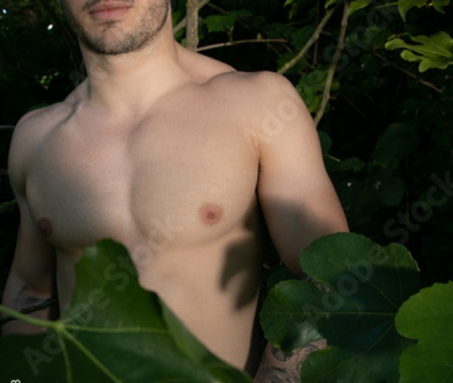 Good Looking Handsome Naked Man With Blue Eyes And Beard Stands Behind Fig Leaf