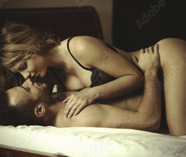 Attractive Woman Kissing And Embracing Husband During Foreplay