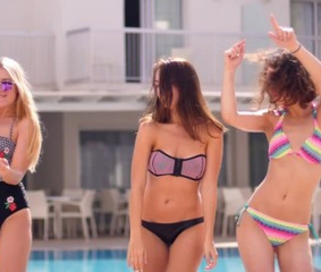 Three Girls In Swimsuits Dancing And Having Fun Friendship Concept Three Young Women Enjoying