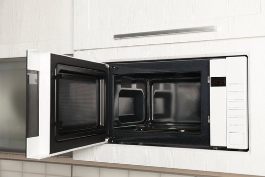 https stock adobe com sk images open modern microwave oven built in kitchen furniture 234376101 start checkout 1 content id 234376101
