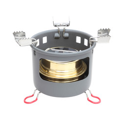 Camping alcohol stove standing on white background.
