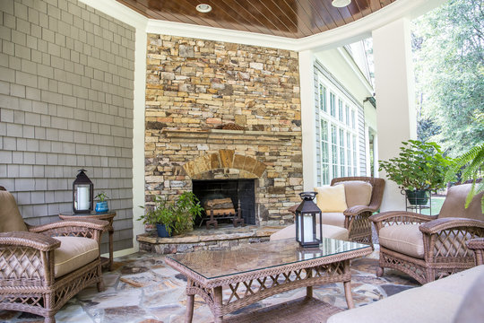 https stock adobe com sk images back stone patio porch of large home with an outdoor fireplace 287025305 start checkout 1 content id 287025305