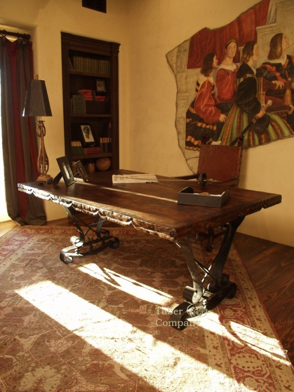 Custom desk, the forged iron legs support a reclaimed mesquite wood top with a hand carved edge.