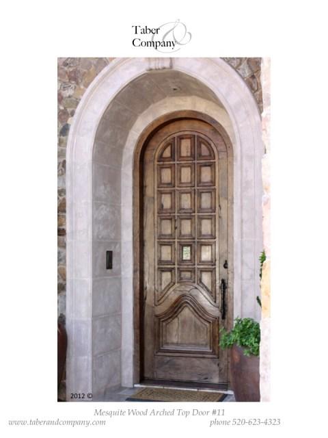 mediterranean style wood door true arch
