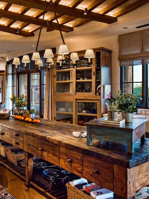 A farmhouse style kitchen island made from reclaimed wood.