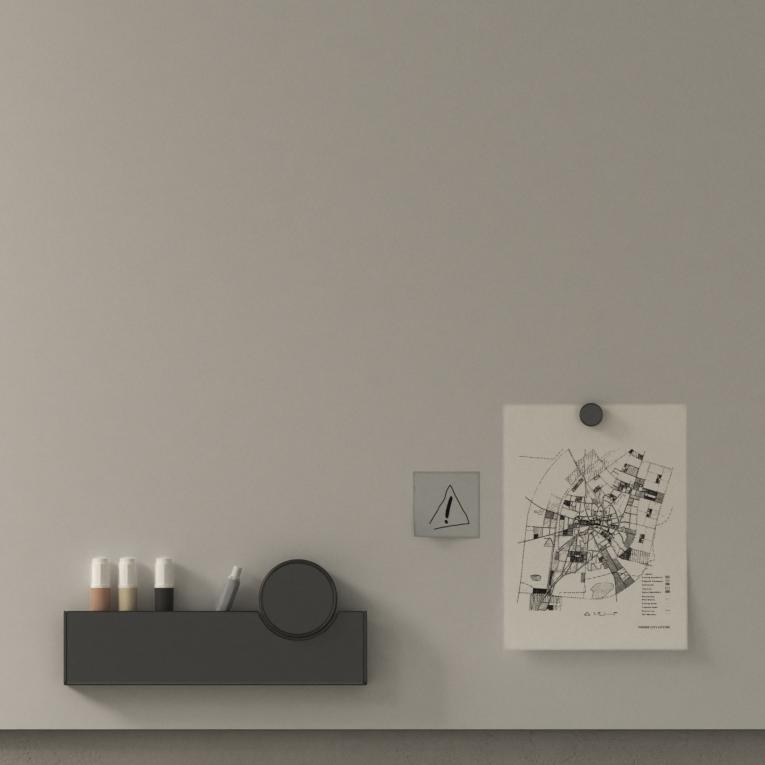 Gray whiteboard with magnetic accessory holding marker and eraser