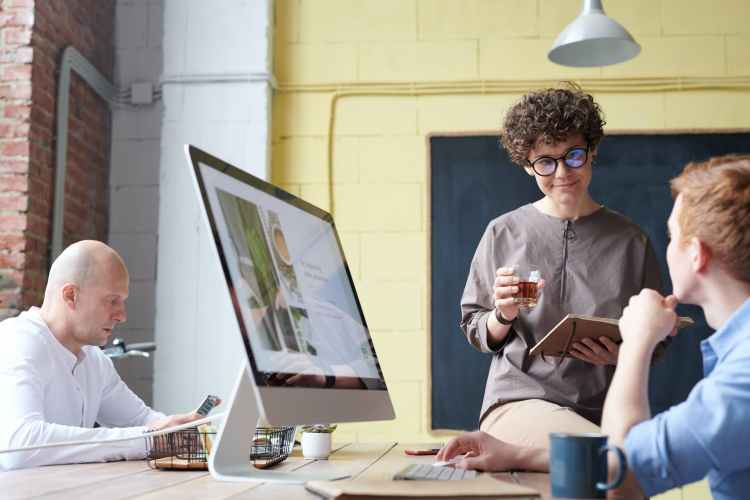 man in blue collared top using imac indoors