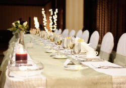 Beautiful white long wedding table with champagn