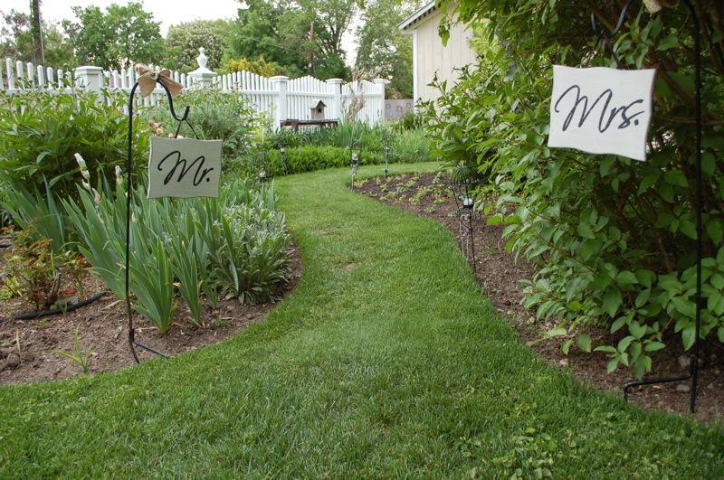 mr and mrs signs on pathway to wedding venue