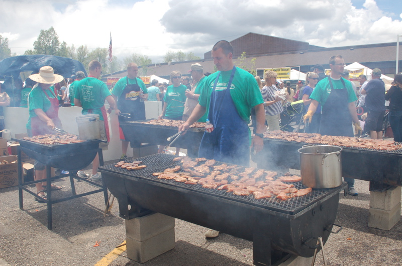 """It's an all-day labor of love to prepare 750 pounds of barbecued turkey breast tenders for an adoring crowd at """"Scandinavian Days."""""""