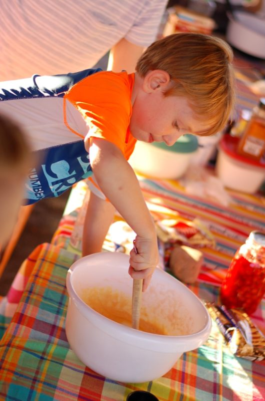 Cooking cherry cobbler dutch oven dessert