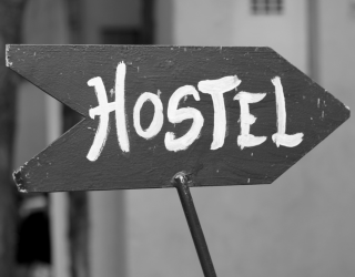 An arrow sign which says HOSTEL