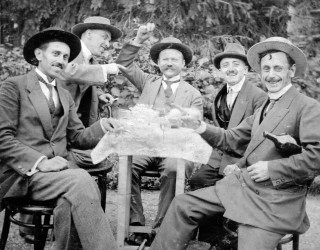 Vintage photo of five men in suits drinking together