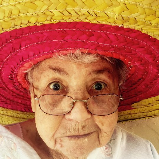 An old woman wearing a giant sombrero