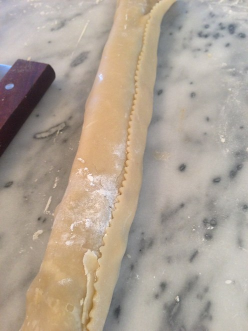 Use a dough scraper to lift and lay dough up and over the fig filling