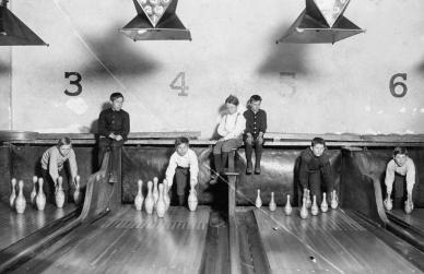 Pin-boys work in the Arcade Bowling Alley in Trenton, New Jersey, on December 20, 1909. The boys worked until midnight and later.