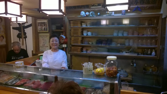 Edokuni Sushi (note picture of Takanohana - in the suit - over her shoulder)