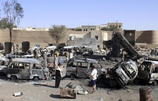 Burnt-out vehicles are seen at a gas station after it was hit by an air strike in Yemen's northwestern city of Saada