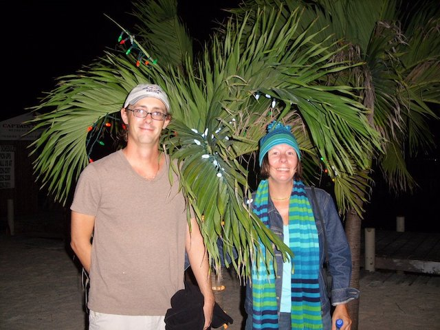 Laurie & Paul standing beside a palm tree