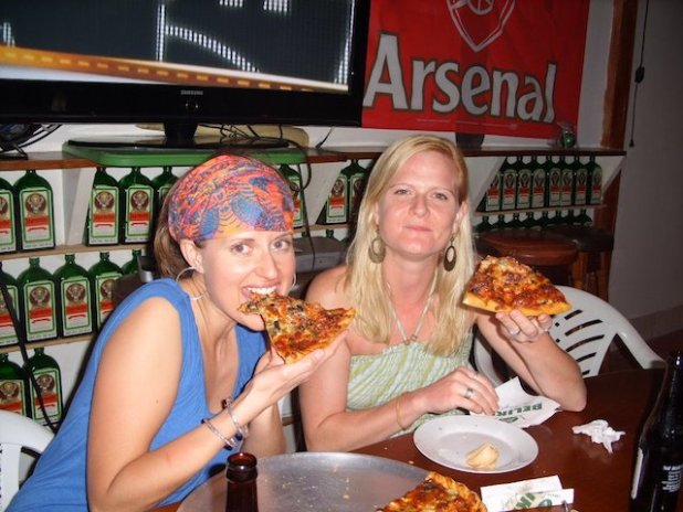 Two women eating pizza at Pedro's