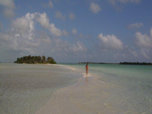 Carole walking along a sandbar